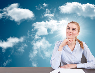businesswoman with head in the cloud