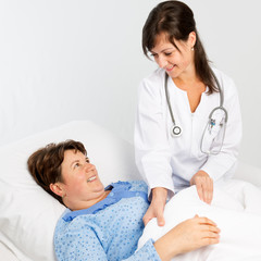 Nurse helping to senior patient