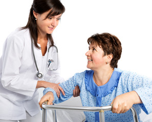Nurse helps a senior patient to get up