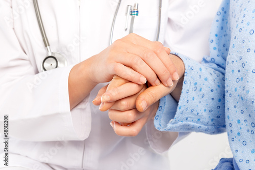 Medical doctor holing senior patient's hands