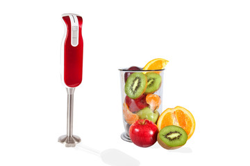 Small electric blender and fresh fruits