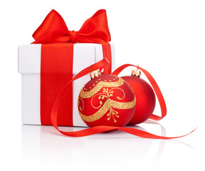 White gift box tied with Red ribbon and two decorations Christma