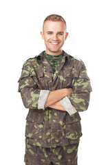 Smiling army soldier with his arms crossed