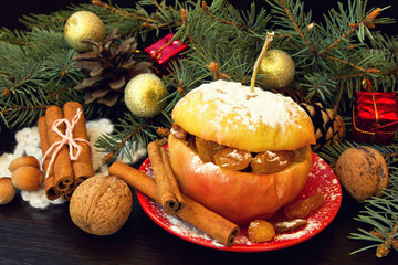 baked apple and decorations. christmas snack