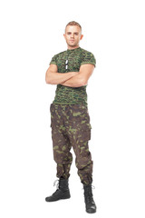 Full length portrait of serious army soldier with his arms cross