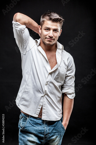 young man on dark background