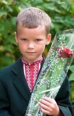 Portrait of nice little schoolboy