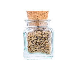 White cumin spice or Cuminum cyminum in a glass bottle