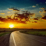 low orange sun over asphalt road