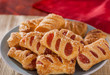 Strawberry and apple filled sugar coated puff pastry cakes close