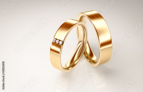 Pair of gold rings with small diamonds for lovers