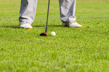 golfer is hitting golf