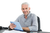 Portrait of a mature businessman with digital tablet at desk