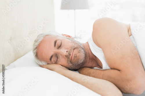 Close-up of a mature man sleeping in bed