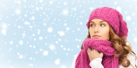 beautiful woman in pink winter hat and muffler