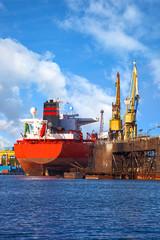 Big ship under repair in Gdansk Shipyard, Poland.