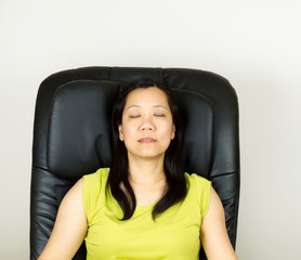 Mature Woman Relaxing in Massage Chair