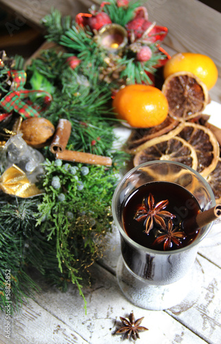 Traditional Christmas punch on the wooden background