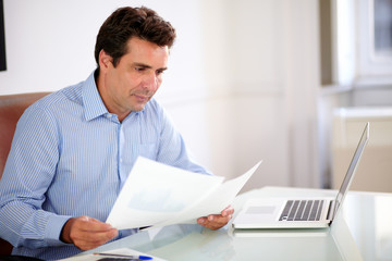Professiona businessman looking at his documents