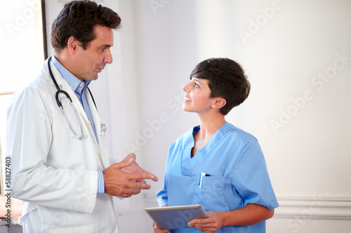 Attractive medical couple standing and conversing