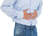 Close-up mid section of a casual man with stomach pain