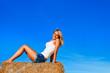 Beautiful woman in jeans short  posing