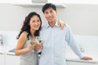 Loving couple with wine glasses in kitchen