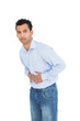 Portrait of a casual young man with stomach pain