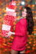smiling woman with many red gift boxes