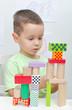 Boy playing with blocks in kindergarten