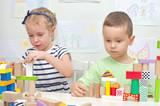 Children playing with blocks in kindergarten