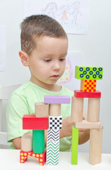 Boy playing with blocks in kindergarten