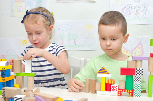 Children playing with blocks in kindergarten