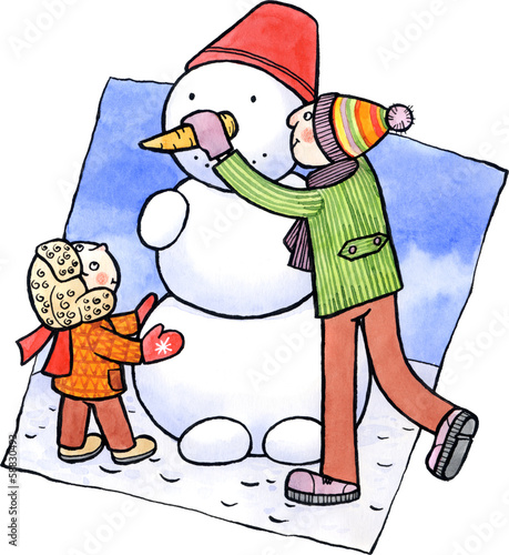 Son and father making a snowman