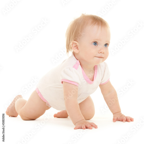 Cute baby with beautiful blue eyes on the white bacgkround