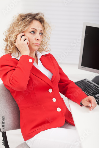 Business woman disappointed by her telephone conversation
