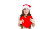 Christmas woman in love, holding a big heart
