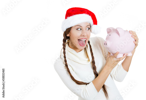 Excited, happy woman holding a piggy bank