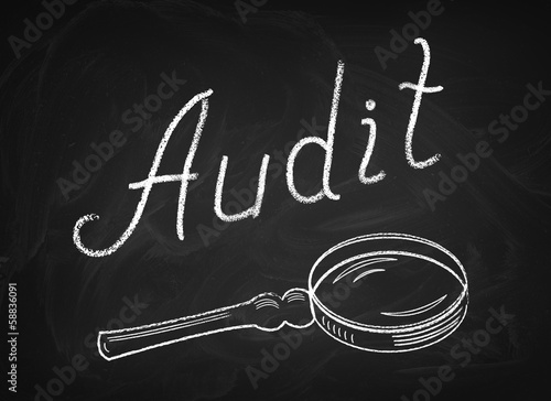 "The chalkboard on which is written in chalk "" Audit """