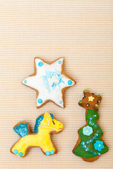 Gingerbread cake pony christmas tree star decoration on brown