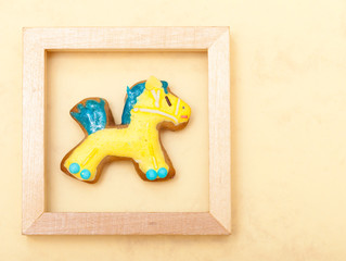 Christmas gingerbread cake pony decoration in frame
