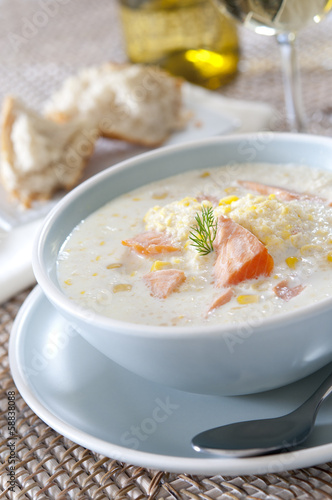 Closeup of a bowl of fresh salmon and corn chowder.