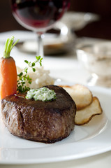 juicy tenderloin steak with potatoes and carrot.