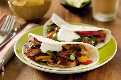 Closeup of a chicken and vegetable fajita.