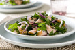 healthy salmon salad with fresh parsley, capers and onions.