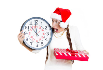 Worried stressed young woman in red santa hat