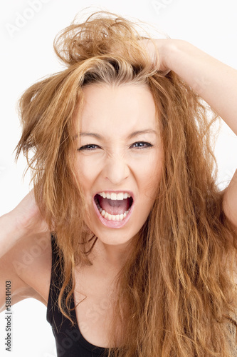 Frustrated Girl with Long Brown Hair Screaming