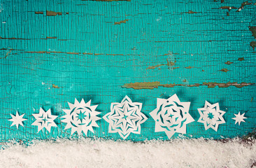 Christmas background with snowflakes cutting out paper