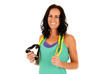 attractive female fitness model smiling after workout