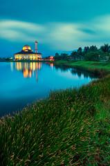 Masjid Darul Quran with full reflection at sunrise